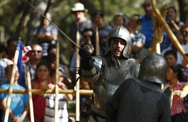 Members of the Show of Arms Society fight with swords during a medieval period re-enactment event in the grounds of Verdala Palace outside Valletta