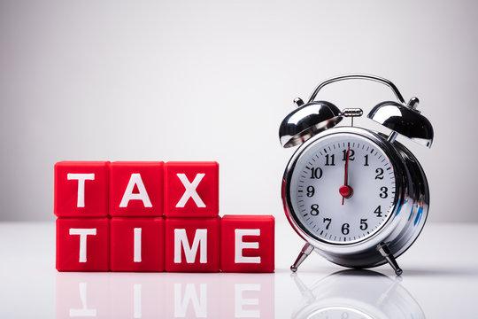 Cubic Blocks With Tax Time Word Near Alarm Clock