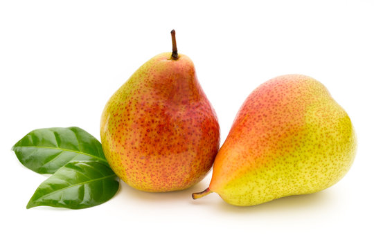 Fresh bio pear with leaves on isolated white background.