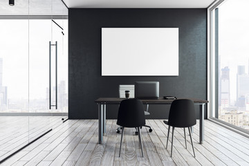 Bright office interior with poster