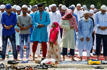 People offer Eid al-Fitr prayers marking the end of the holy fasting month Ramadan on a road in Kolkata