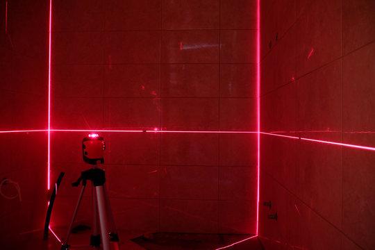 Laser measurement during bathroom renovation