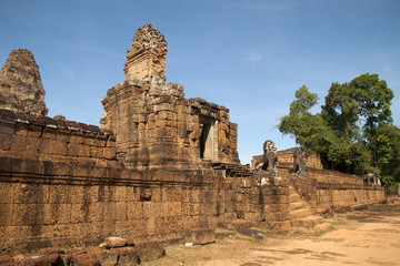 Siem Reap Cambodia, view of entrance at East Mebon a 10th century hindu temple with stone animal statues on staircase