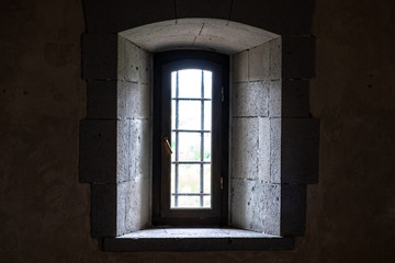 Window in the medieval fortress view from the room.