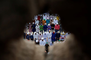Muslims offer Eid al-Fitr prayers marking the end of the holy fasting month of Ramadan at a mosque in Ahmedabad