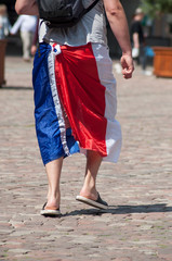 closeup of french supporter of football with french flag on legs in outdoor