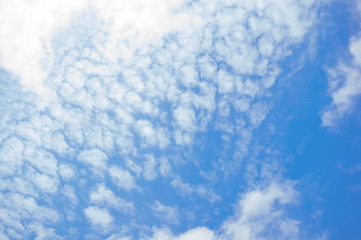 White fluffy clouds background.