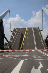Steel drawbridges of the sluice Julianasluis over the Gouwe in Gouida are open.