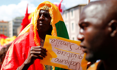 People take part in a national demonstration to show solidarity with migrants, after Soumaila Sacko a 29-year-old migrant agricultural worker was shot and killed in southern Italy early this month, Rome