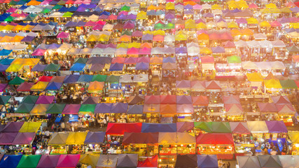 Night flea market multiple colour roof top, cityscape background
