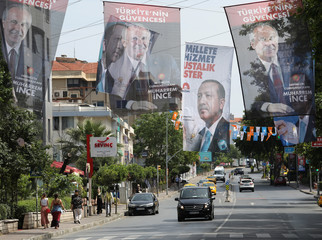 Banners of Turkish President Tayyip Erdogan and  banners of Muharrem Ince, presidential candidate of the main opposition Republican People's Party (CHP) hang in a street in Istanbul