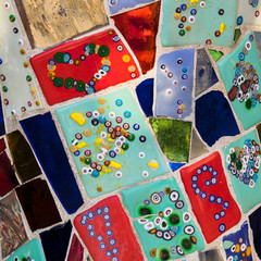 Wall made of  multicolored ceramic pieces.
