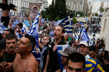 Protesters shout slogans during a demonstration against the agreement reached by Greece and Macedonia to resolve a dispute over the former Yugoslav republic's name, in Athens
