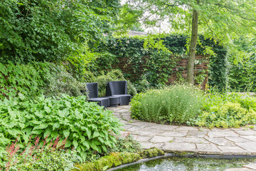 Garden design with water element and rounded patway