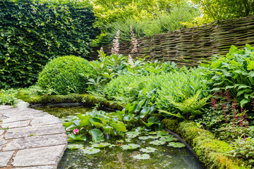Garden design with water element and rounded flagstones