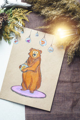 Kight lamp with picture of kind bear with fish in lamp flat lay