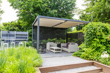 Garden design with grey metal rooftop and patio