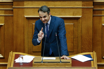 Greek conservative New Democracy party leader Kyriakos Mitsotakis addresses lawmakers during a parliamentary session before a vote following a motion of no confidence by the main opposition in dispute over a deal on neighbouring Macedonia's name, in Athens