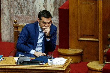 Greek Prime Minister Alexis Tsipras attends a parliamentary session before a vote following a motion of no confidence by the main opposition in dispute over a deal on neighbouring Macedonia's name, in Athens