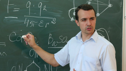 Teacher of chemistry leading lecture in colledge.