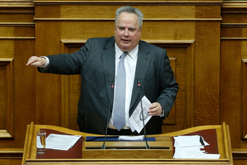 Greek Foreign Minister Nikos Kotzias addresses lawmakers  during a parliamentary session before a vote following a motion of no confidence by the main opposition in dispute over a deal on neighbouring Macedonia's name, in Athens