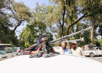 A Taliban on a vehicle celebrates ceasefire in Bati Kot district of Nangarhar province, Afghanistan