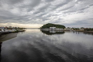 River mouth with clouds loaded with rain