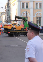 A damaged taxi, which ran into a crowd of people, is evacuated in central Moscow