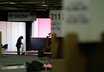 Workers put the final details in an polling station ahead of June 17 second round of presidential election in Bogota