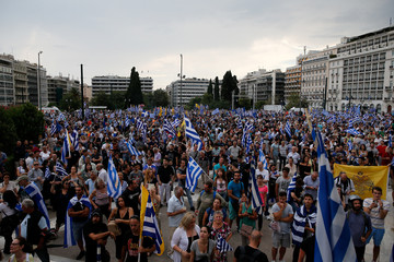 Protesters take part in a demonstration against the agreement reached by Greece and Macedonia to resolve a dispute over the former Yugoslav republic's name, in Athens