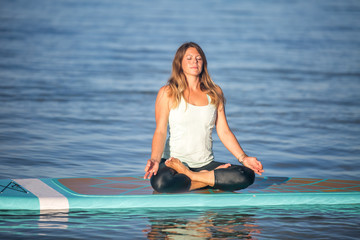 Sunrise SUP Yoga practice  in Waikiki meditation