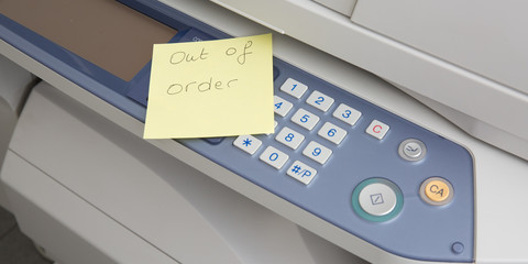 photocopy machine with note indication that out of order