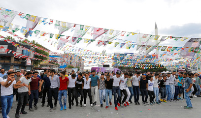 Supporters of pro-Kurdish Peoples' Democratic Party (HDP) dance during a campaign event in Istanbul