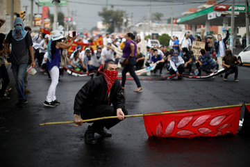 A man participates in a protest against privatization of water in San Salvador