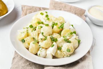 Potato salad with eggs and green onion
