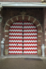 Red and white decorations on the doors and window shutters of De Haar Castle.