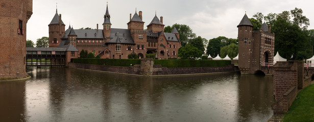 The beautiful De Haar Castle reflected in the surrounding moat on the castle grounds