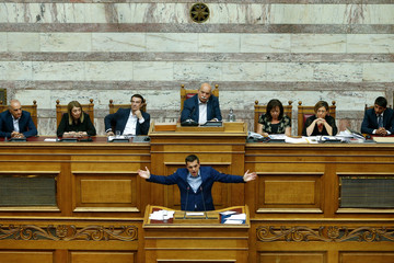Greek Prime Minister Alexis Tsipras addresses lawmakers during a parliamentary session before a vote following a motion of no confidence by the main opposition in dispute over a deal on neighbouring Macedonia's name, in Athens