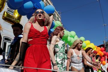 Participants march during the Gay Pride Parade in downtown Lisbon