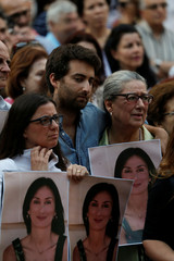 Family members of assassinated investigative journalist Daphne Caruana Galizia attend a vigil and demonstration marking eight months since her murder in a car bomb, in Valletta