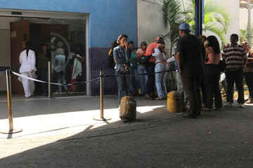 Relatives of people who died at Los Cotorros club when a person activated a tear gas grenade inside, according to Venezuela's interior minister Nestor Reverol, react outside the Perez Carreno hospital in Caracas