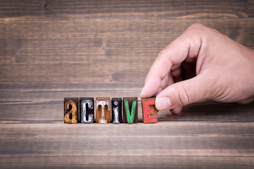 active, communication and business concept. Wooden letters on the office desk, informative and communication background