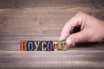 Boycott, communication and business concept. Wooden letters on the office desk, informative and communication background
