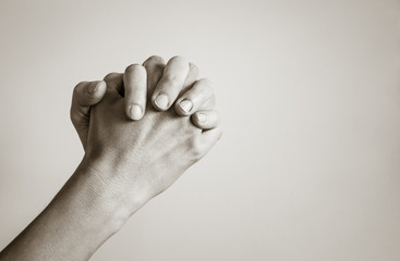 Closeup of folded hand praying.