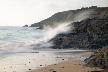 Waves crashing on rock