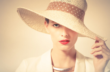 Attractive portrait of woman wearing hat.