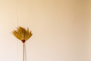 Hand made broom on the old background