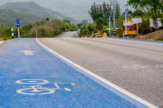 Blue bicycle lane signage on street