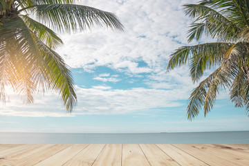 Top of wood table with  sea and coconut tree