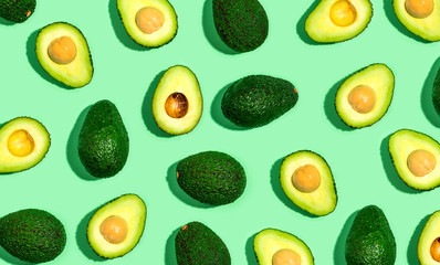 Fresh avocado pattern on a green background flat lay Wall mural